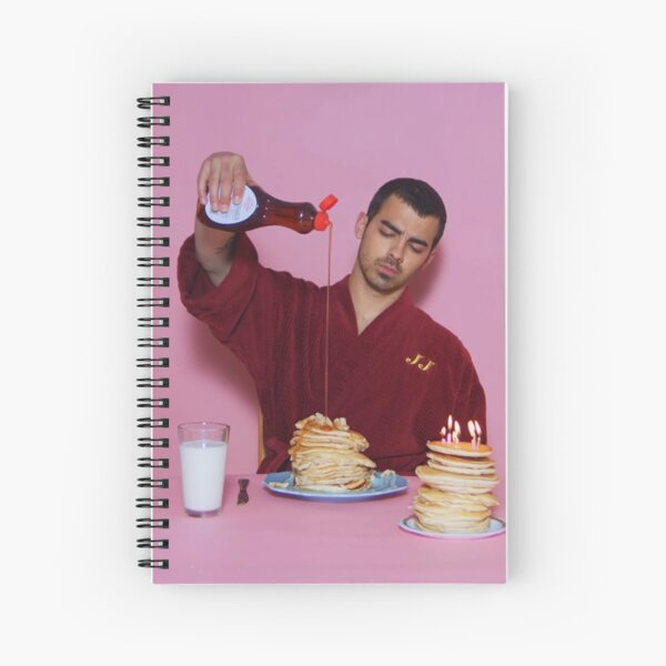 Joe Jonas pouring syrup over some pancakes SQUARE! Spiral Notebook
