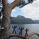 Clay people climbing trees by Vicky Stonebridge