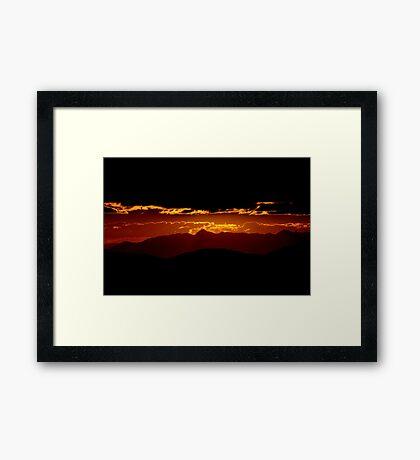 Mountain ridges and sunset Framed Print