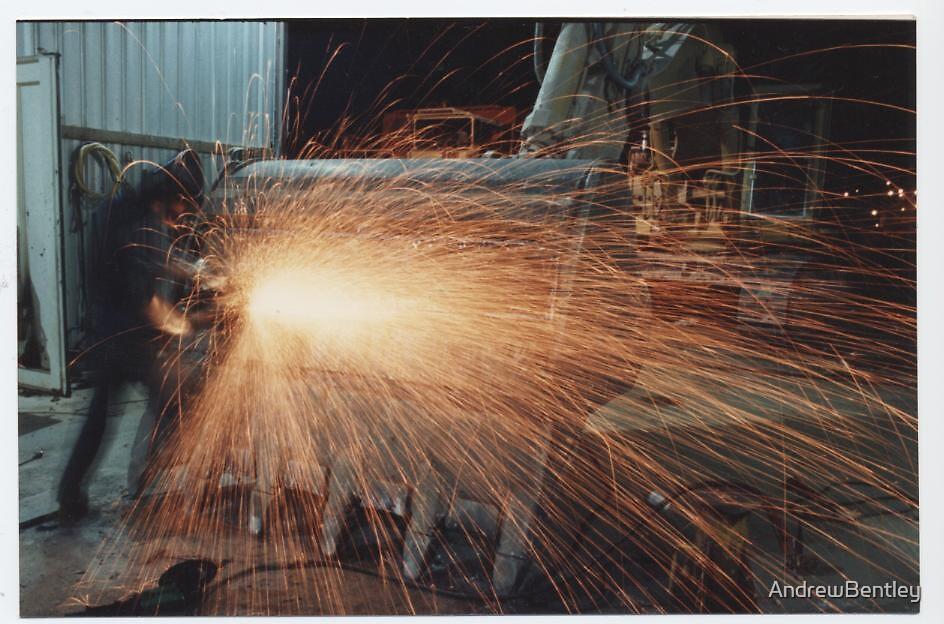 Excavator bucket grinder sparks by AndrewBentley