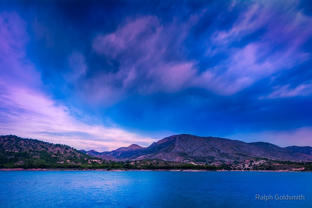 Mad sky over mountains by Ralph Goldsmith