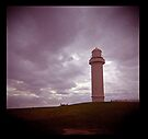 big lighthouse on the hill by Juilee  Pryor