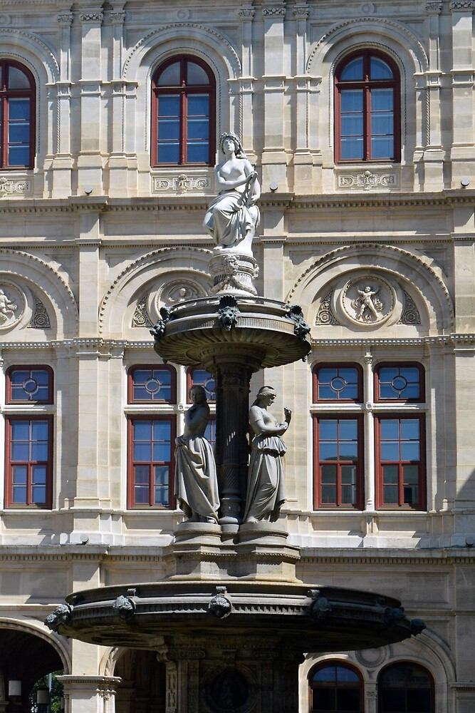 Beautiful classical building in Vienna, Austria with a sculpture by oanaunciuleanu