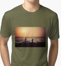 Two silhouttes of men in the sunset with surf boards at a sandy beach, Komos, Crete, Greece Tri-blend T-Shirt