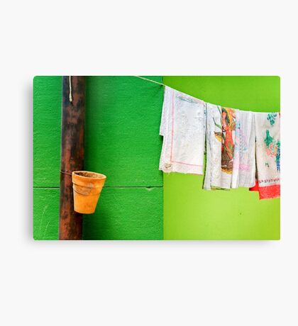 Vase, towels and green wall Canvas Print