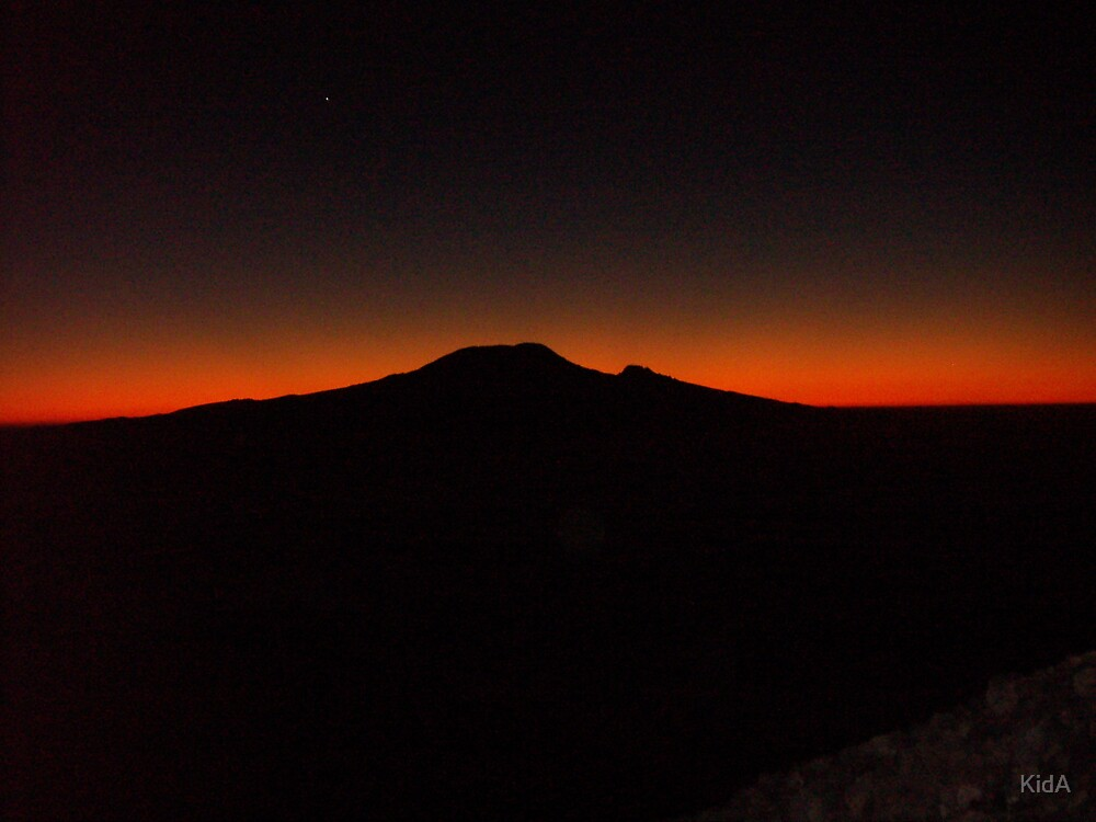 En route to summit of Mt Meru at sunrise with silhouette of Mt Kilimanjaro piercing the horizon by KidA