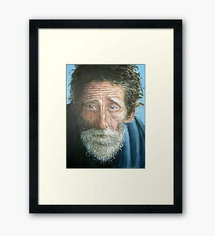 Man with the world in his eyes Framed Print