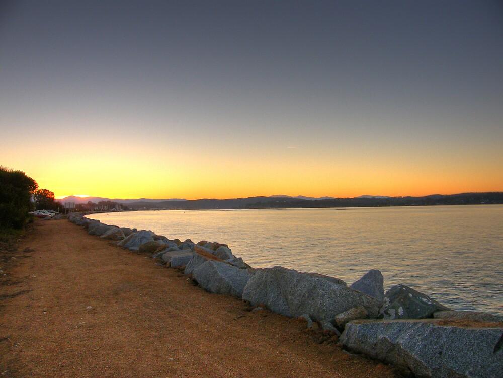sunset on the breakwater by Joel Wigley