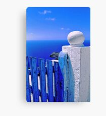 Greek blue gate with wandering clouds Canvas Print