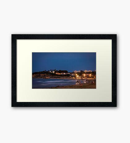The beach at night Framed Print