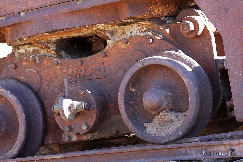 Wheels on an old coal mining cart  by Deborah  Allen
