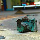 Bronze Nikon SLR by Tony Hadfield