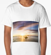 long exposure sunset at low tide as the waves move around a rocky beach Long T-Shirt