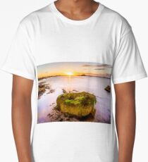 Long exposure smooths the waves as they come round a large rock as sunset Long T-Shirt