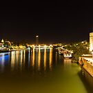 Seville Night Magic - Torre del Oro and Guadalquivir River in Bright Gold by Georgia Mizuleva