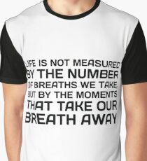 Life Is Not Measured By The Number Of Breaths We Take, But By The Moments That Take Our Breath Away.  Graphic T-Shirt