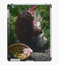 Young woman smelling roses in a garden art print iPad Case/Skin