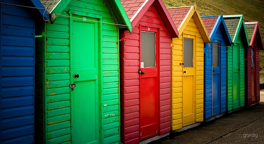Colourful chalets at Whitby by gordy
