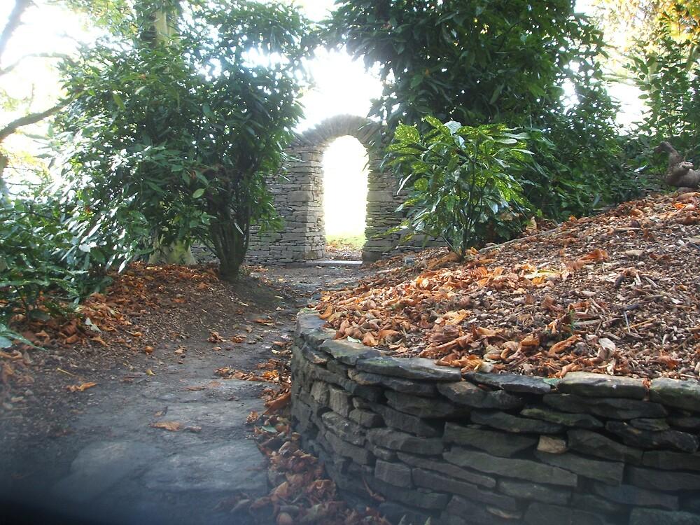 Arched gateway in the garden of Joanne Harris by RichardArtist
