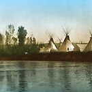 Crow Indian Tipi Camp on the Rivers Edge by DanKeller