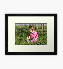 little girl with kid pet Framed Print