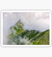 Steep slope on rocky hillside in fog Sticker