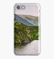 lake in mountains with grass on hillside iPhone Case/Skin