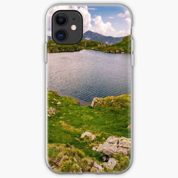 lake in mountains with grass on hillside iPhone Soft Case