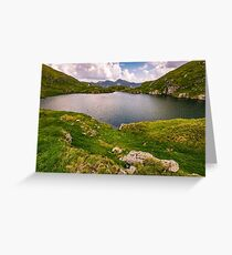 lake in mountains with grass on hillside Greeting Card