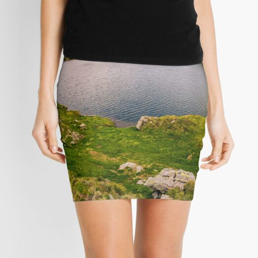 lake in mountains with grass on hillside Mini Skirt