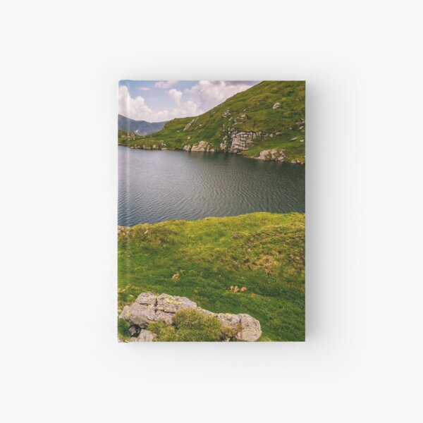 lake in mountains with grass on hillside Hardcover Journal