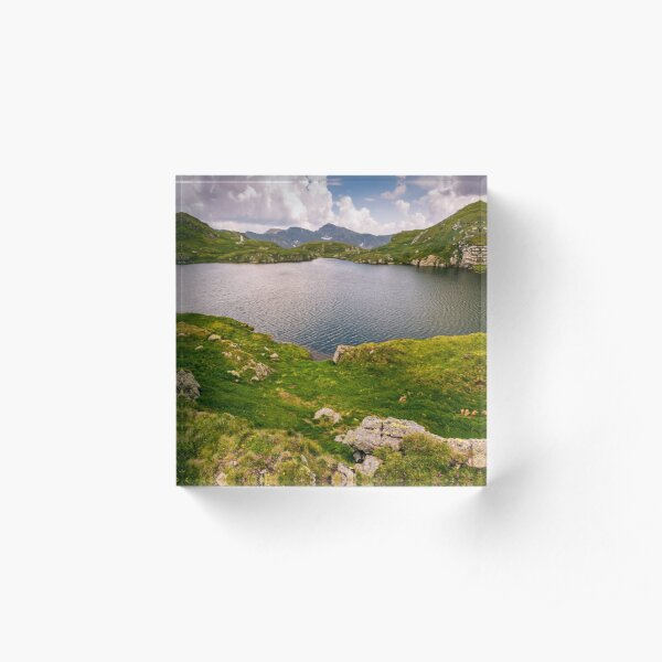 lake in mountains with grass on hillside Acrylic Block