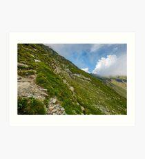 Steep slope on rocky hillside in clouds Art Print
