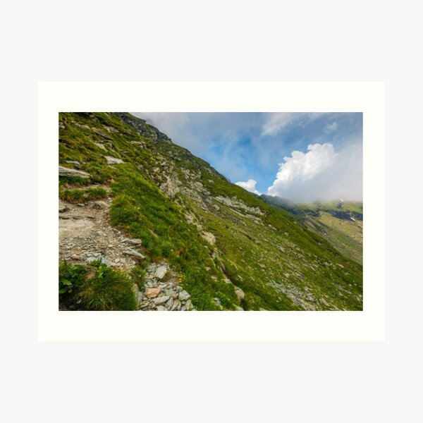 Steep slope on rocky hillside in clouds Art Print