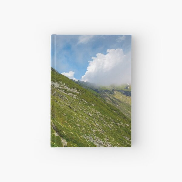 Steep slope on rocky hillside in clouds Hardcover Journal