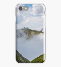 high mountain peak in clouds among the hills iPhone Case/Skin