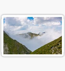 high mountain peak in clouds among the hills Sticker