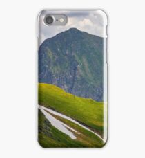 rocky edge on grassy hillside with snow  iPhone Case/Skin