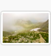 Steep slope on rocky hillside over balea lake in fog Sticker