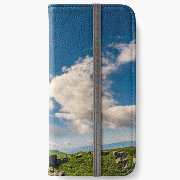 sunburst on a blue sky with clouds over the mountains iPhone Wallet