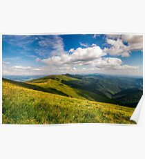 grassy meadow on hillside of mountain ridge Poster