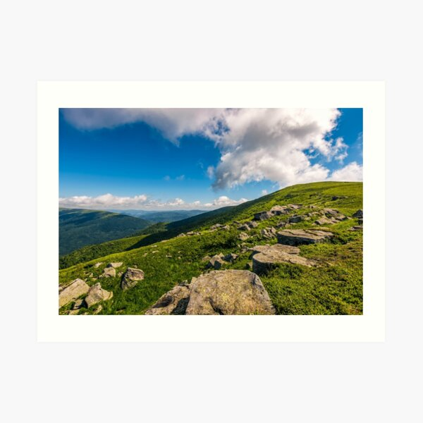 blue cloudy sky over the mountains with rocky hillside Art Print