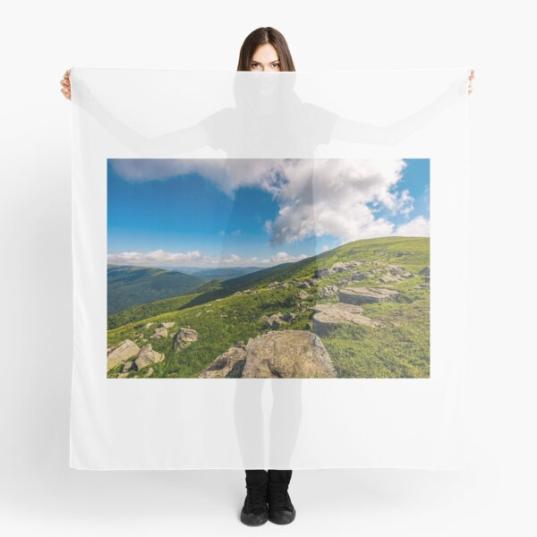 blue cloudy sky over the mountains with rocky hillside Scarf