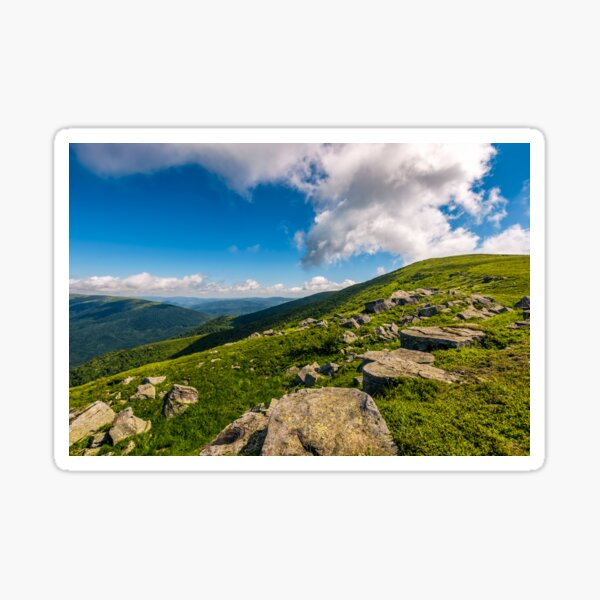 blue cloudy sky over the mountains with rocky hillside Sticker