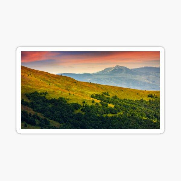 mountain ridge with peak behind the hillside at sunset Sticker