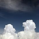 White clouds against the blue sky by OlgaBerlet