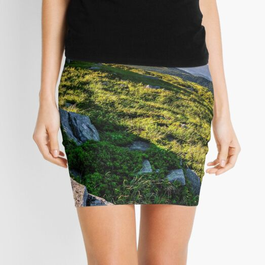hillside with boulders in Carpathian mountains in summer Mini Skirt