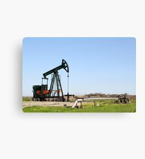 oil field with pump jack Canvas Print