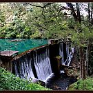 Waterfall At Jenolan Caves by Alexey Dubrovin