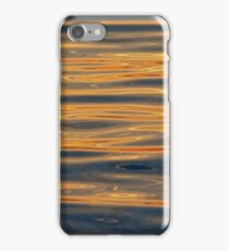 Reflections of te evening sun in rippling water iPhone Case/Skin